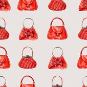Ladies' handbags red background. — Stock Photo