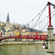 Footbridge on Saone river — Stock Photo
