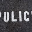 Stock Photo: Police word in asphalt