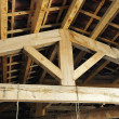 Inside the roof structure with wooden beams — Stock Photo #38384781