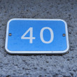 Grey stone adress plate number fourteen 40 — Stock Photo #38385407