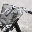 Handlebars and bicycle basket — Stock Photo
