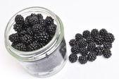 Blackberrys in glass jam — Stock Photo