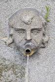 水ドロップの花崗岩の顔 — ストック写真