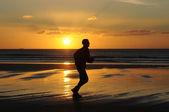 Man running on beach — Stock Photo