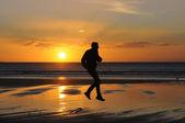 Man jumping on beach — Stock Photo