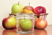 Apples in glass jars — Stock Photo