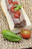 Steak sandwich with pepper and tomato — Stock Photo