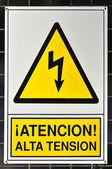 Yellow poster shock hazard — Stock Photo