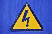 Blue poster shock hazard — Stock Photo