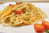 Spaghetti with tomato and spices in olive oil — Stock Photo