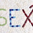 Stock Photo: Word sex written with capsules and pills