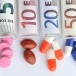 Stock Photo: Medical pills in euro banknotes