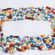 Stock Photo: Multi colored pills and tablets