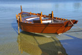 Wooden boat in the beach — Stock Photo