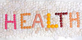 Word health written with tablets and pills — Foto Stock