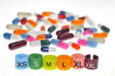 Different sizes in the fashion and its close relationship with drugs — Stock Photo