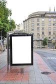 Billboard on bus stop — Stock Photo
