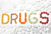 Word drugs with color pills — Stock Photo