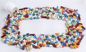 Multi colored pills and tablets — Stockfoto