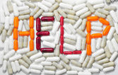 Word help with tablets and pills — Stock Photo