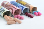 Medical pills in euro banknotes — Stock Photo