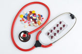 Doctors Stethoscope with pills and tablets treatment — Stock Photo