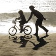 Girl learning bike with his mother — Stock Photo #38963221
