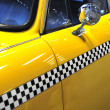 Checkered taxicab — Stock Photo #38963887