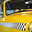 Checkered taxicab — Stock Photo #38964799