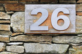 Number 26 to steel embedded in wood — Stock Photo