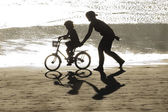 Girl learning bike with his mother — Stock Photo