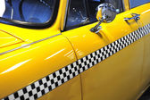 Checkered taxicab — Stock Photo
