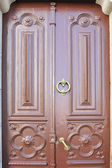 Large and stately wooden doors — Stock Photo