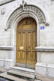 Large and stately wooden doors — Photo