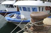 Old rusty iron mooring a fishing port — Stock Photo
