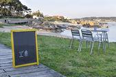 Poster board Restaurant menu on the beach. — Stock Photo