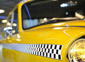 Checkered taxicab — Stockfoto