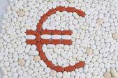 Pills with euro symbol — Stock Photo