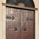Doors with bronze door knockers — Stock Photo