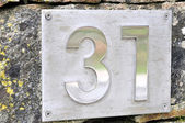 Adress number 31 to steel embedded in granite — Stock Photo