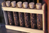 Grains of specialty coffee in glass tubes — Stock Photo