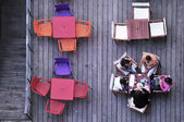 FIve people enjoying leisure on a terrace — Stok fotoğraf