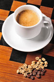 Coffee cup with grains — Stock Photo