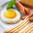 English Breakfast - sunny-side-up fried eggs, sausages, beans, bacon and toasts served with coffee — Stock Photo #38738151