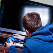 Stock Photo: Teenager playing games