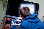 Teenager playing games — Stock Photo