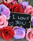 Love message with roses — Stock Photo