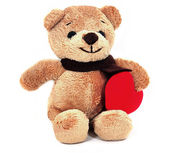 Teddy Bear holding a heart. — Stock Photo