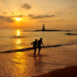 Silhouette romantic scene of couples on the beach with sunset ba — Stock Photo #38280147